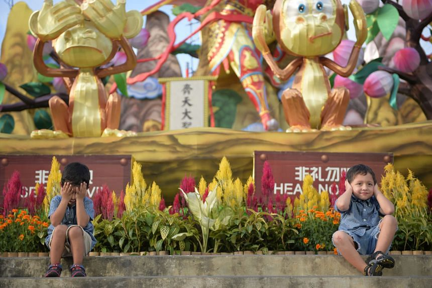 Three-year-old Francisco Tapia (left) and his brother Pedro, five, posing for a shot by their parents during a visit to the opening of the River Hongbao 2016 light-up, yesterday. The Ecuadorian family of four are in Singapore on a holiday.