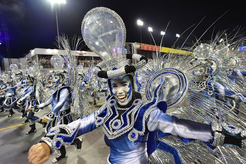 Samba dancers performing at the Sambadrome in Sao Paulo on Saturday. The mega bash is expected to attract one million tourists.