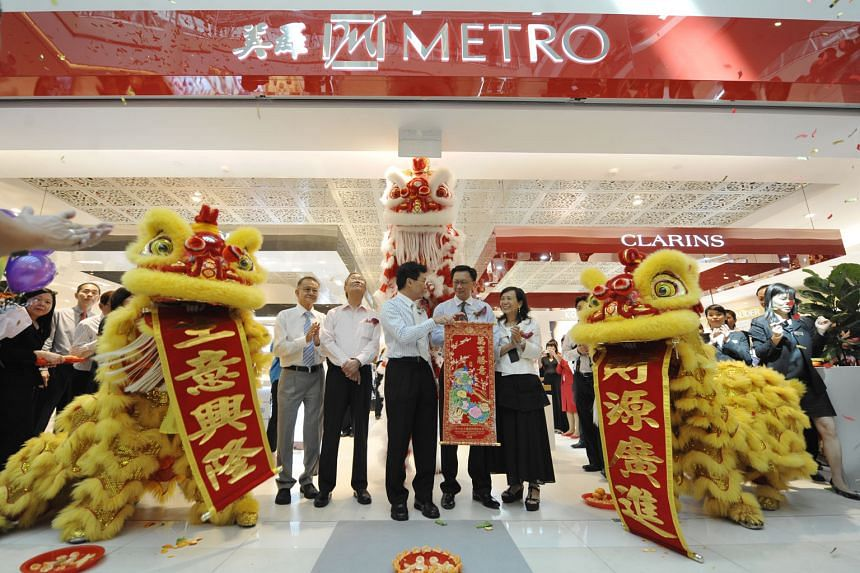 Mr Jopie Ong (above) died at the age of 75. Left: Mr Ong (second from left) at the opening of Metro City Square Mall in 2009 by Mr Lee Yi Shyan (centre), then Minister of State for Trade and Industry.