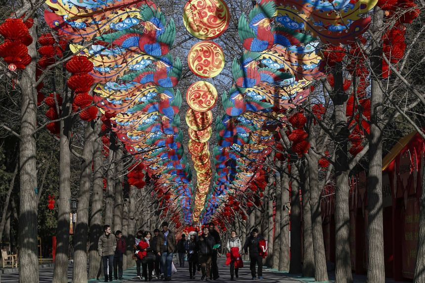 While many parts of China, such Ditan Park in Beijing (above), are being decked out in festive colours for the Spring Festival, many Chinese families, such as that of IT executive You Lan, 42, are choosing to spend Chinese New Year abroad this year.