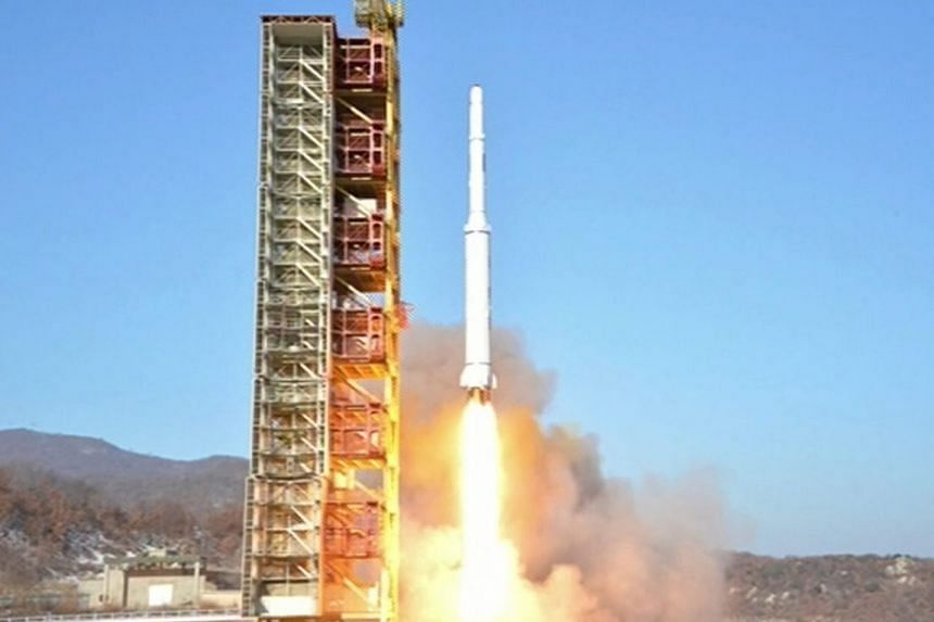 North Korea's Kwangmyongsong-4 satellite being fired from a launch site in North Pyongan province yesterday.
