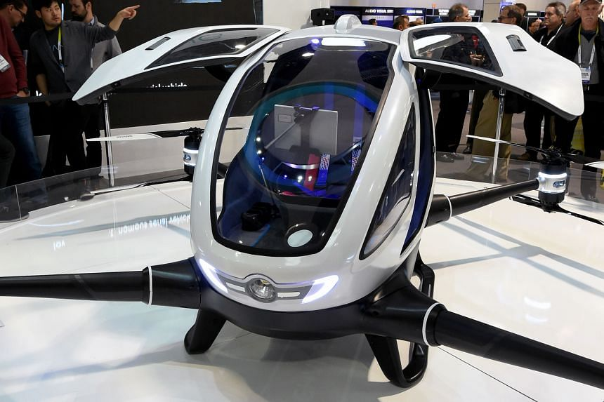 Attendees of the Las Vegas Consumer Electronics Show last month looking at the EHang 184, believed to be the world's first passenger drone. The drone can carry one passenger, who does not need to pilot it. Once a destination is entered, only a take-o