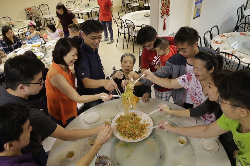 Madam Tiow Seng (centre, seated), 92, enjoying a four-generation reunion lunch with (clockwise from left) her son Michael Chan, 54; grandson Chan Hong Kai, 25; daughter-in-law Regina Chan, 51; son George Chan, 60; grandson Dex Lee, 39, carrying his 1