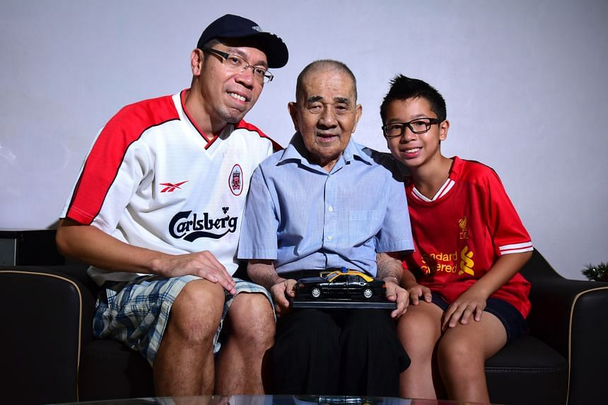 Tang Wanbao, the winner of the top prize of The Straits Times-Komoco Motors Euro 2016 contest, with his father and son.