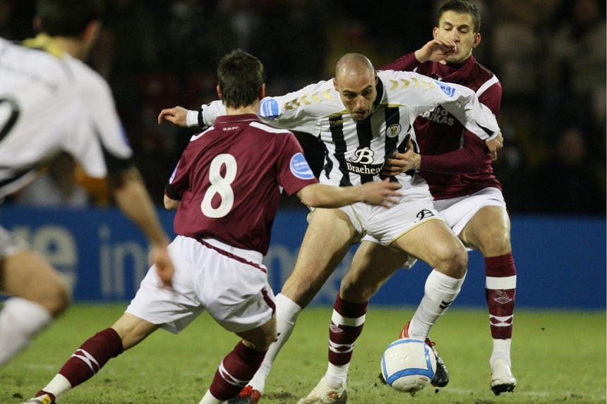 Billy Mehmet on the attack for St Mirren in February 2010 against Hearts' Ian Black (left) and Ismael Bouzid, in their Scottish League Cup semi-final. He scored the only goal but his team lost in the final.