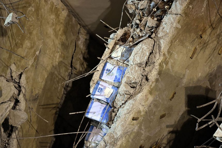 Metal cans seen between layers of concrete at the collapsed Wei-guan complex in Tainan. At least 39 people were killed when the building toppled early last Saturday.