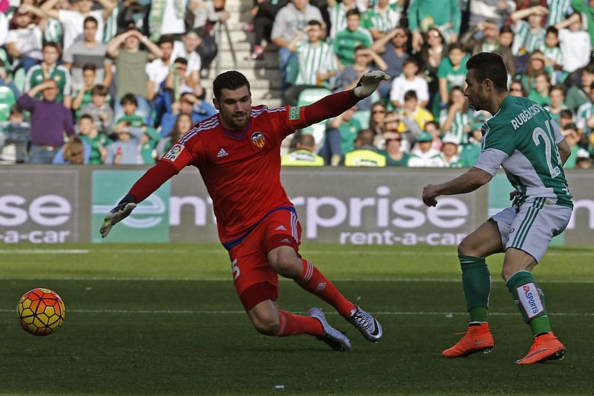 Betis striker Ruben Castro scoring the winner past Valencia goalkeeper Matthew Ryan. While coach Gary Neville has faced the brunt of criticism during their poor run, the whole team have been below par.