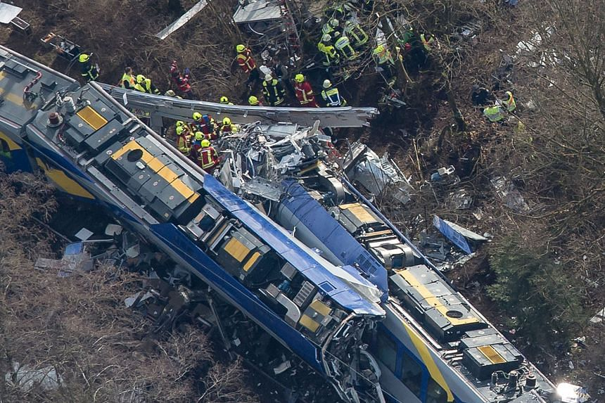 The carnage left behind after two commuter trains crashed head-on yesterday near Bad Aibling, a spa town south-east of Munich. Hundreds of firefighters, emergency services workers and police officers were deployed in the rescue, which was made more c