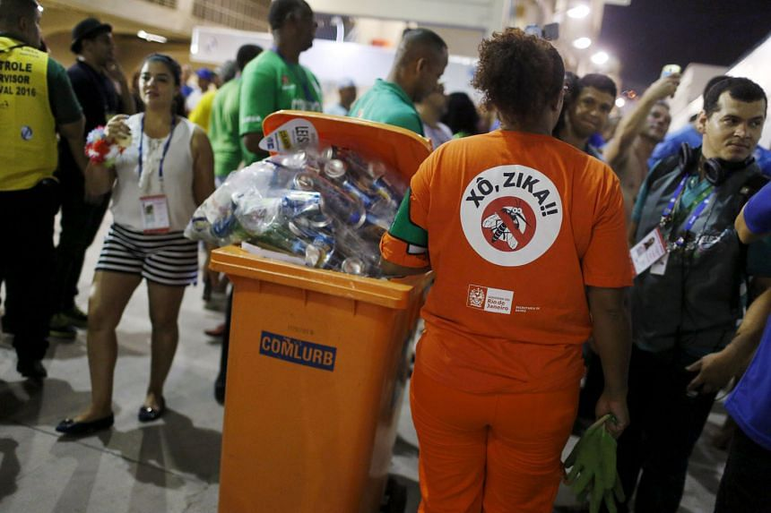 """A woman in Rio de Janeiro wearing a T-shirt that reads """"Out Zika"""". Brazil, which will host the Olympics in August, has been the country hardest hit in the current outbreak."""