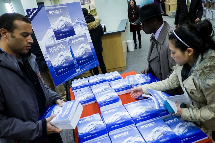 Copies of President Obama's Fiscal Year 2017 Budget on sale at the Government Publishing Office bookstore in Washington, DC on Tuesday. Mr Obama said the plan, which covers spending on everything from cyber security to the environment, will advance U