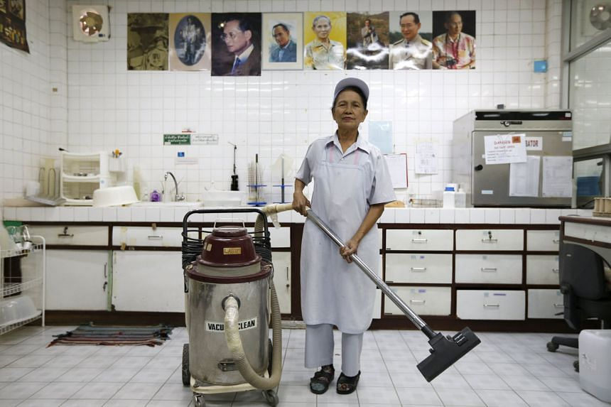 Madam Darunee Kamwong (top) is a factory cleaner while Madam Pranom Chartyothin (above) is a bus conductor. Both are 72 years old and among a growing group of elderly employees in Thailand where the working-age population is expected to shrink by 11