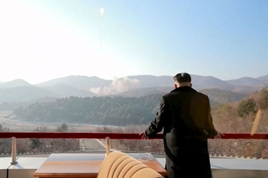 North Korean leader Kim Jong Un watching the launch of a long-range rocket in a Yonhap release on Feb 7. Separately, US national intelligence director James Clapper says the Obama administration now regards North Korea, rather than Iran, as the world