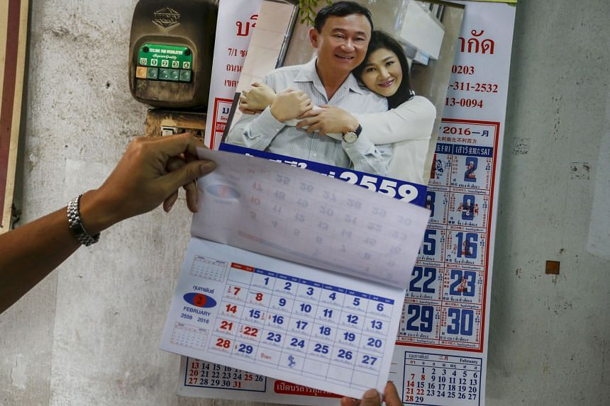 Calendars featuring former Thai prime ministers Thaksin and Yingluck Shinawatra are banned from distribution in Thailand.