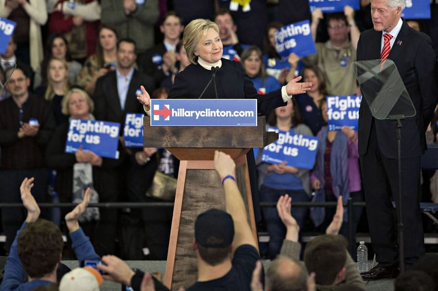 Mrs Hillary Clinton speaking at a primary night event in Manchester, New Hampshire, on Monday with her husband Bill Clinton (right) beside her. The success of the Clinton campaign is dependent on her beating rival Bernie Sanders among women and attra