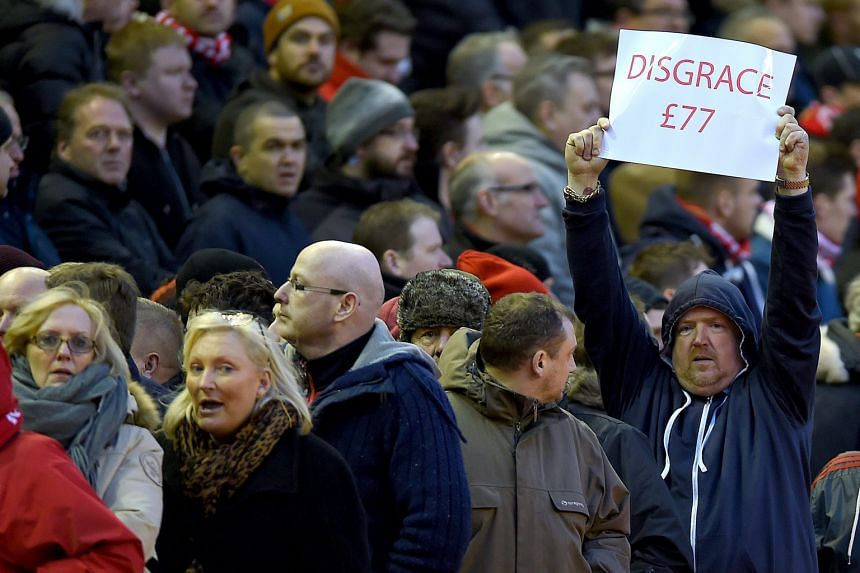 Liverpool fans walking out of Anfield stadium on Saturday in protest against the club's proposal to increase ticket prices from next season. Their stance found widespread support among fans from other clubs and even earned the backing of British Prim