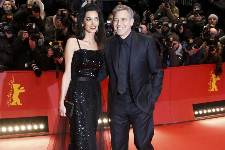 George Clooney and his wife Amal on the red carpet for the screening of the movie Hail, Caesar!, in Berlin, Germany.