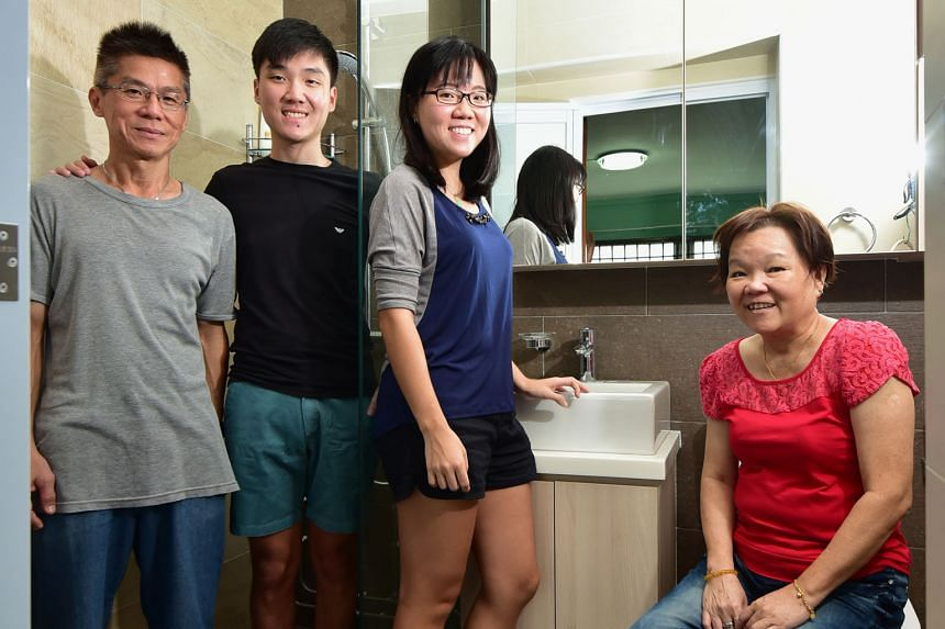 """Miss Jasmine See (third from left) with her dad Victor, brother Nicholas and mum Joyce in their renovated, """"hotel-concept"""" bathroom."""