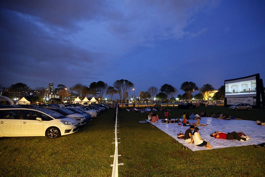 Viewers at a drive-in movie event organised in Tanjong Rhu yesterday evening by Citroen and Cycle and Carriage to celebrate 10 years of partnership ahead of Valentine's Day today. A separate picnic area was set aside for those who did not drive in. A