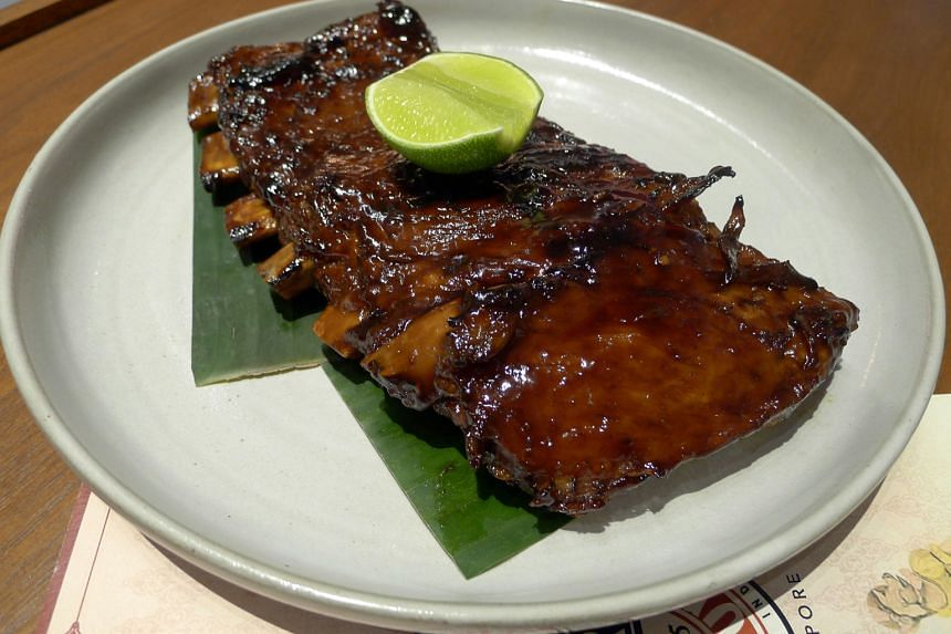 Signature barbecued pork ribs ($18.80 for half rack, $35.80 for full rack),