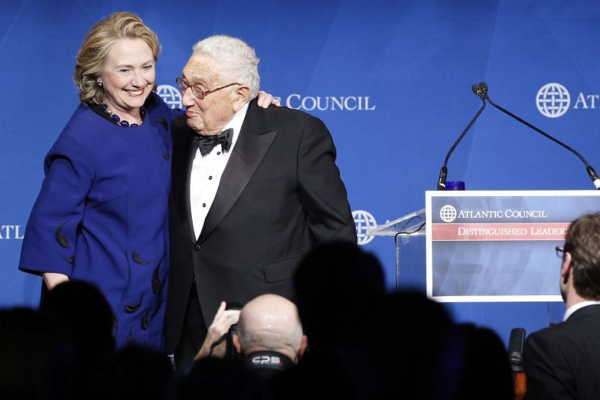 Clinton supporters are afraid that her friendship with Mr Kissinger - seen here presenting Mrs Clinton with a Distinguished Leadership Award from the Atlantic Council in Washington in 2013 - is hurting her presidential chances.