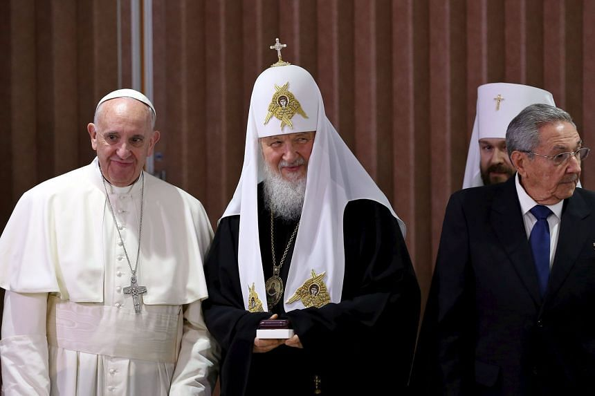 (From far left) Pope Francis, Patriarch Kirill and Cuban President Raul Castro at Havana's international airport on Friday.