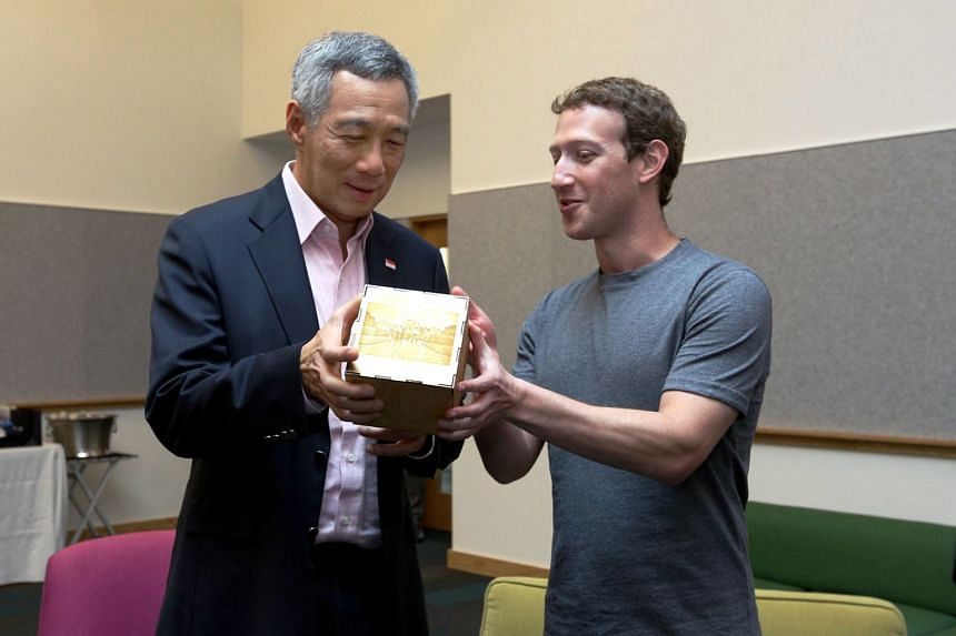 Mr Lee met Apple chief Tim Cook (left) and Facebook chief Mark Zuckerberg on his second day in Silicon Valley. In recognition of Mr Lee's ability to code, Mr Zuckerberg presented him with a cube which included lines from a computer program the PM wro