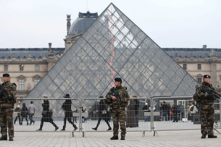 Attendance in Paris museums such as The Louvre (left) has dropped since the Islamist attacks last year.