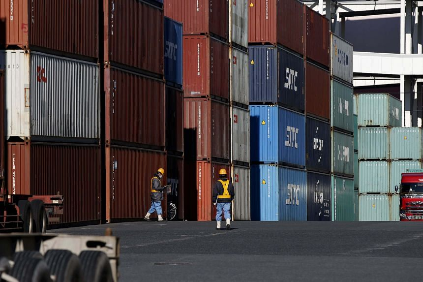A container port in Tokyo. Japan releases its fourth-quarter economic figures today, while China will make public its trade figures for last month.