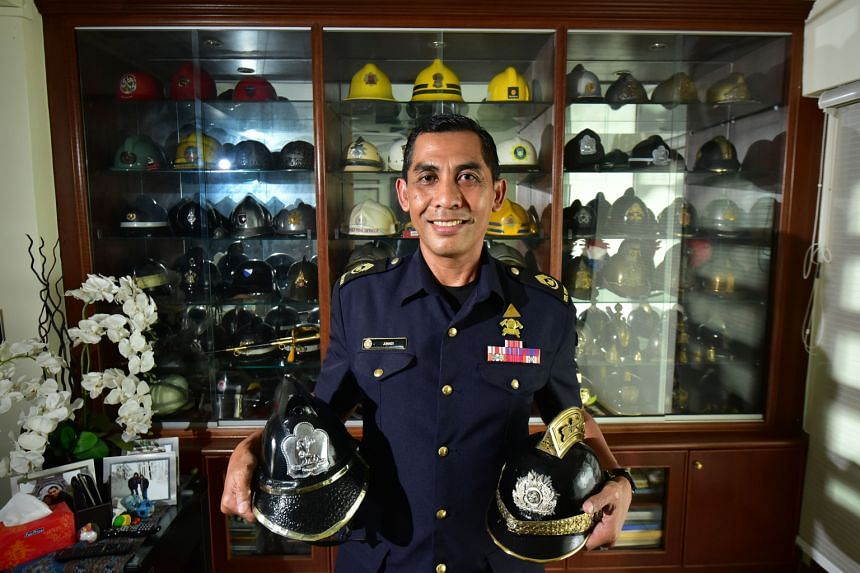 SWO Junaidi with two of his most prized items - a vintage Greek fire brigade helmet (right) and a leather helmet from the now-defunct Singapore Fire Brigade. The 55-year-old says the most meaningful part of his hobby is his cultural exchange with for