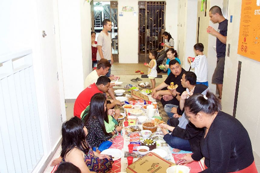The Kampung Makan group gets residents in a Sembawang neighbourhood to eat together along their corridors every month.