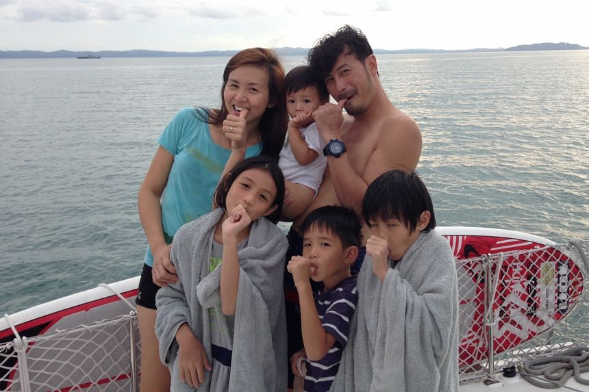 Former actress Evelyn Tan and husband, actor Darren Lim, with two-year-old son Elliott and their other children (front, from left) Kristen, 11, Way, seven, and Jairus, nine, on their trip to Sibu, Malaysia, last year.