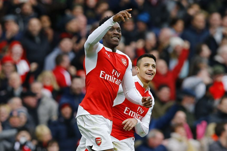 Danny Welbeck celebrates his goal against Leicester City with team-mate Alexis Sanchez. Welbeck's winner helped Arsenal narrow Leicester's lead to two points.
