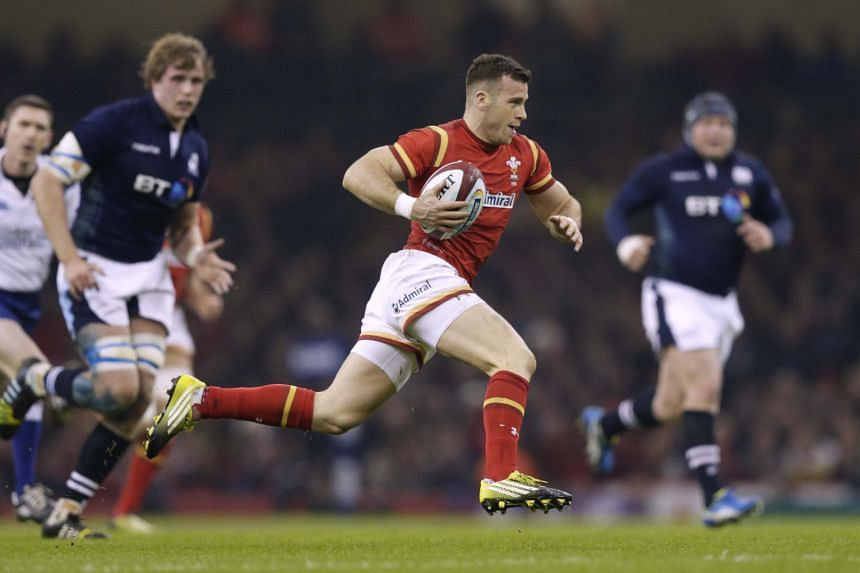 Gareth Davies of Wales runs in to score his team's first try. Scotland's players felt the try should have been ruled out for offside, but the referee awarded it and the Scots fell to their ninth straight loss against the Welsh.