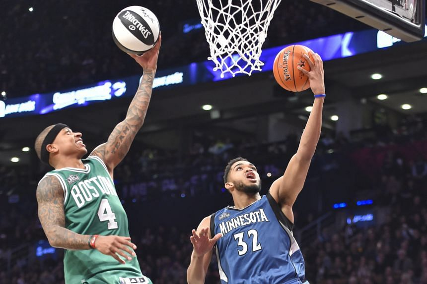 The 2.13m Minnesota centre Karl-Anthony Towns (right) was an unlikely winner over Boston guard Isaiah Thomas in Saturday's Skills Challenge.