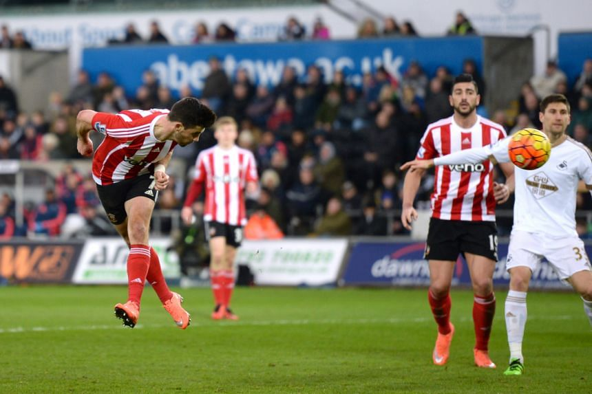 Southampton's Shane Long (left) heading home against Swansea in the 69th minute to score the game's only goal and help his side to a 1-0 away win.