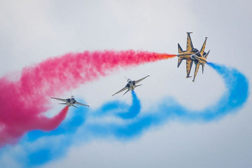 Members of the Republic of Korea Air Force's Black Eagles flying South Korean-made T-50 jets as they executed death-defying high-speed manoeuvres off the Changi coast. The renowned aerobatics team is in town for the Singapore Airshow 2016. SEE TOP OF