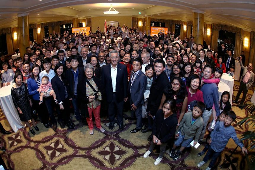 PM Lee and his wife, Mrs Lee, with Singaporeans in the US at a Chinese New Year event in San Francisco. The guests included students, working professionals and families.