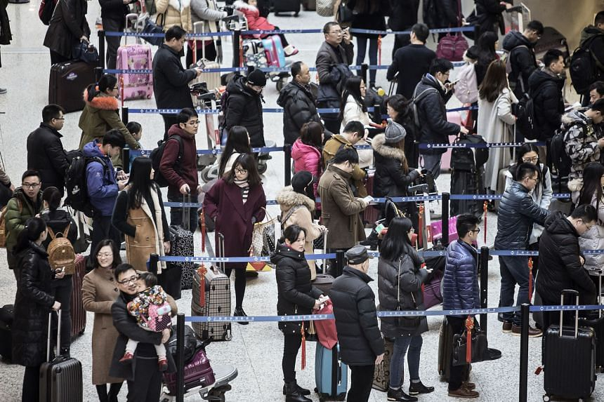 Travellers waiting to check in at Shanghai Hongqiao International Airport. To work around the country's cash controls, people in China are asking friends or family members to carry or transfer out US$50,000 each.