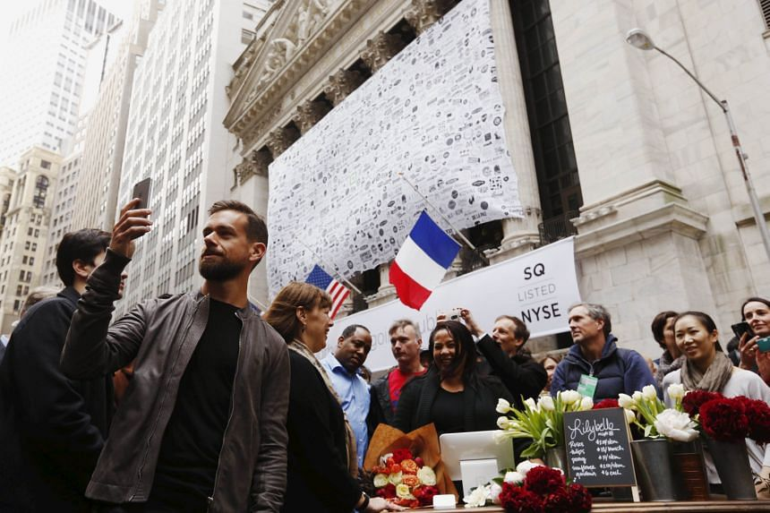 Twitter chief executive Jack Dorsey (in grey jacket) wants to bring the focus of the business back to what it does best: live events. Here, he is live-casting a video outside the New York Stock Exchange.