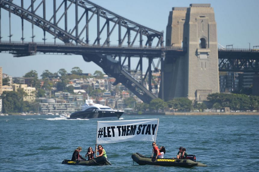 Activists campaigning in front of the Harbour Bridge in Sydney yesterday to stop the return of 267 refugees to the Nauru detention facility. The asylum seekers had been brought to Australia for medical treatment.