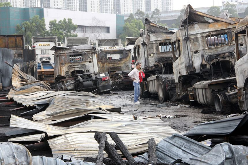 A suspected arson attack has destroyed 32 vehicles, including coaches, trucks and tractors, parked at an outdoor carpark in Hong Kong's Lai Chi Kok in New Kowloon, the South China Morning Post reported. No casualties were reported following the fire,