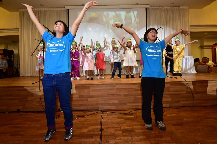 "Ms Yeo Soo Cheng (far left) and Ms Anna Ong, both volunteers from Blossom World, performing with the Blossom Kids. More than 1,000 people celebrated Valentine's Day and the seventh day of the Chinese New Year (""Ren Ri"" or the birthday of mankind) ove"
