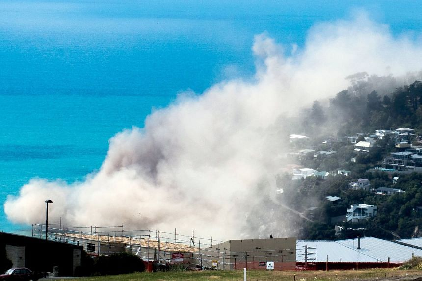 Dust and debris rising above houses after a cliff collapsed during an earthquake in the Whitewash Head area, above Scarborough Beach in the Christchurch suburb of Sumner. The mayor of Christchuch said the new quake was a big shock to the city. In 201