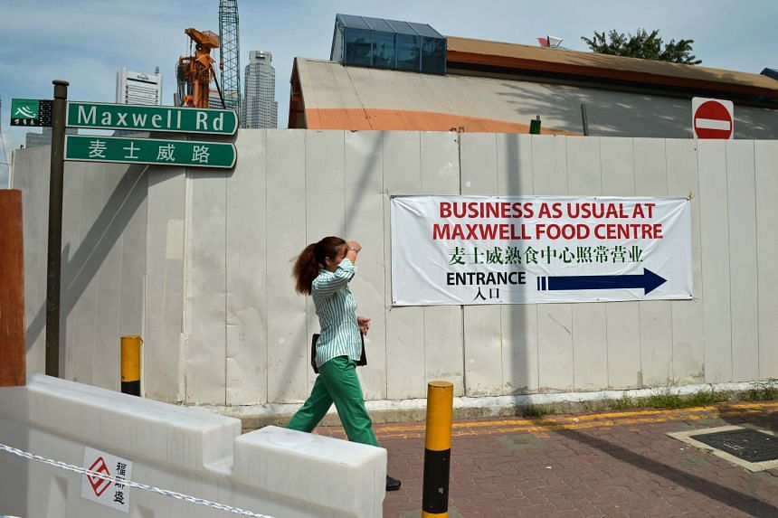 Hawkers at Maxwell Food Centre say business started to drop when hoardings went up in the middle of 2014, and worsened when a nearby carpark closed last March because of ongoing MRT construction work. They appealed to both NEA and URA for help.