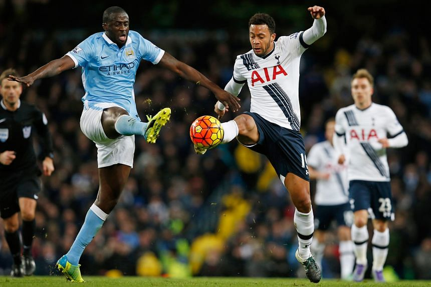 Manchester City's Yaya Toure (left) and Tottenham's Mousa Dembele in action on Sunday.
