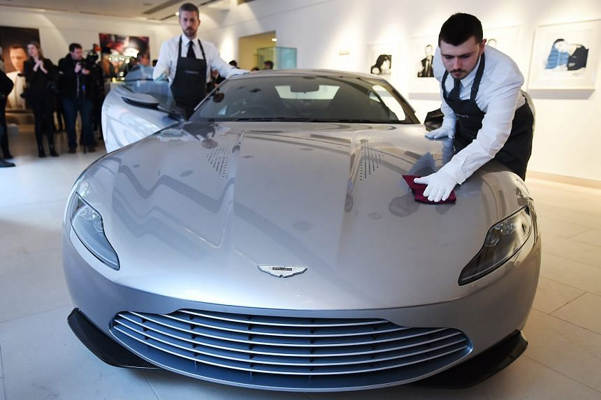 Christie's auction house staff polishing an Aston Martin DB10 during the James Bond Spectre auction press preview at Christie's in London, Britain, yesterday. The DB10 is expected to fetch €1.2 million (S$1.9 million) to €1.7 million at an online