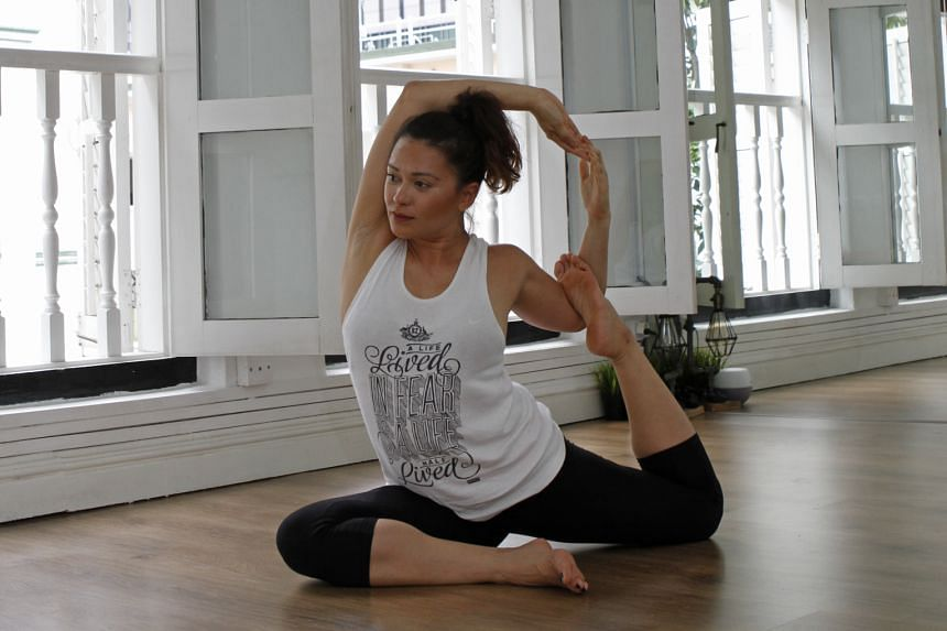 Yoga is part of ONE FM 91.3 radio DJ Cheryl Miles' fitness routine and it helps to ease her back pain.