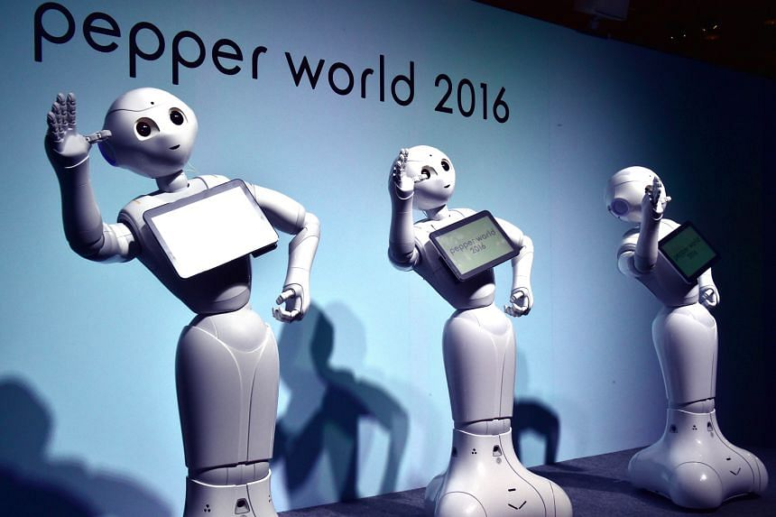 """""""Pepper"""" humanoid robots dancing to attract customers at an exhibition in Tokyo last month. Professor Bart Selman of Cornell University said computers are """"starting to 'hear' and 'see' as humans do"""". Business giants such as Google, Facebook, IBM, Mic"""