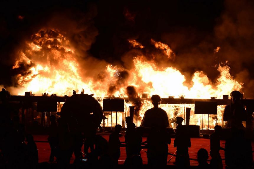 Fanned by high winds, the fire quickly spread, licking the sides of a scaffolding rig and lighting up the night sky at a cultural event on Sunday. The inferno was believed to have been caused by an electrical short circuit and 14 fire engines and 10