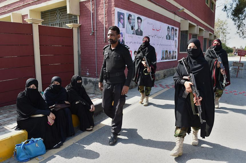 Pakistani police commandos patrolling the premises of Bacha Khan University in Charsadda after it reopened yesterday. Gunmen stormed the institution on Jan 20 in a rampage that left 21 dead.